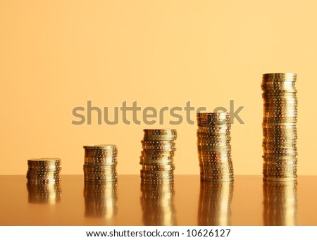 towers of gold coins on the table