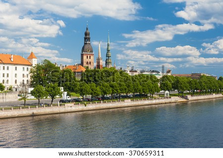 Towers of Riga and castle seen across river Daugava. Three church towers in the picture are the Riga Dome cathedral,  St. Saviour's Church and St. Peter's church.  - stock photo