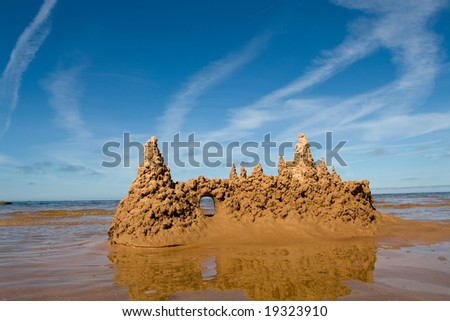 Towers of sand castle at the seaside - stock photo