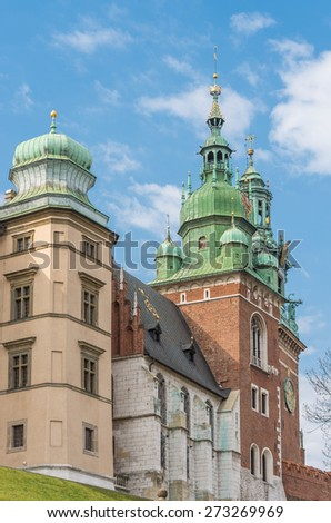Towers of the cathedral of St Stanislaw and St Vaclav and royal castle on the Wawel Hill, Krakow, Poland. - stock photo