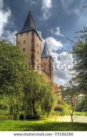 Towers of the medieval castle in Rochlitz with blue sky and white clouds - stock photo