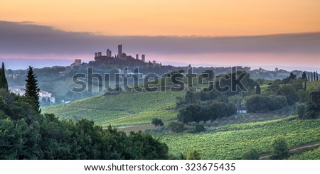 Towers of World Heritage Site Village San Gimignano on the top of a Hill during Sunrise, Italy - stock photo