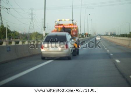 Towing a trailer on the highway. - stock photo