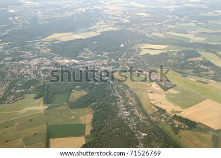 Town and fields in Europe, view from a flying plane - stock photo