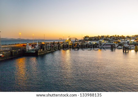 town and harbor of Playa Blanca from seaside in the evening - stock photo