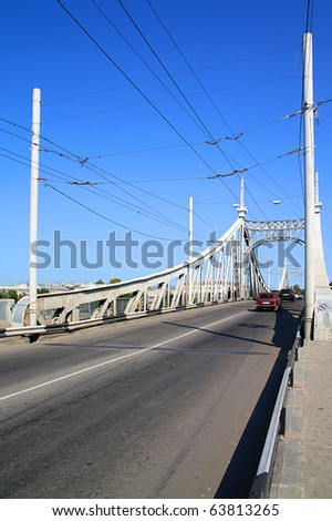 town car bridge through river - stock photo