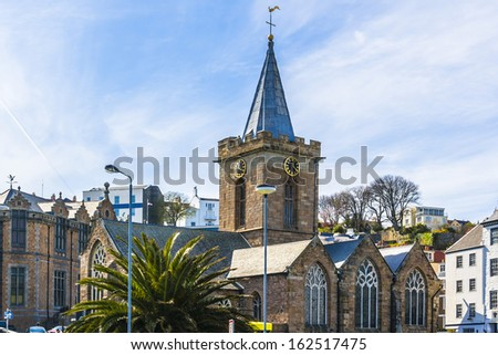 Town Church. Saint Peter Port - capital of Guernsey as well as main port. Guernsey (officially the Bailiwick of Guernsey) is a British Crown dependency in English Channel off the coast of Normandy. - stock photo