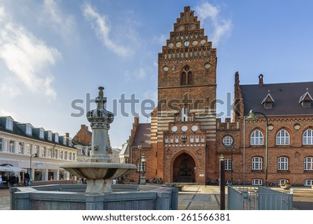 Town hal in Roskilde is 19th century building in Neo-gothic style. The Gothic tower, the only remain of the St. Lawrence church, built in the early 12th century and destroyed during the Reformation.  - stock photo