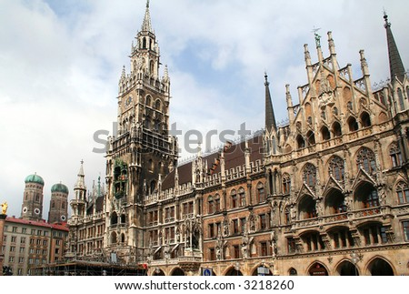 Town hall building in Marienplatz, Munich, Germany. Frauenkirche towers in the background. - stock photo