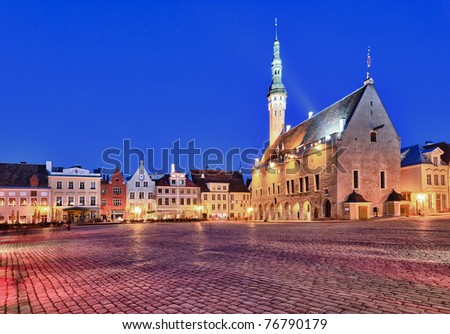 Town hall in Raekoja square in Tallinn in Estonia at dusk as the buildings are illuminated - stock photo