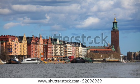 Town Hall (Stadshuset) on King's Island in Stockholm, on the shores of the Riddarfjard, great landmark and emblem of the Swedish capital. - stock photo