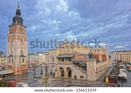 Town Hall Tower and Cloth hall in the Main Market Square of the Old City in Krakow in Poland at Christmas - stock photo