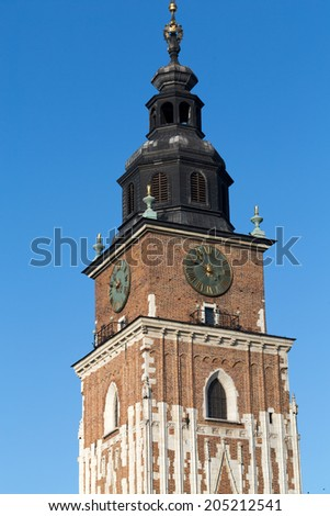 Town hall tower on main square of Cracow - stock photo