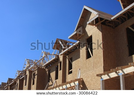 Town home construction - stock photo
