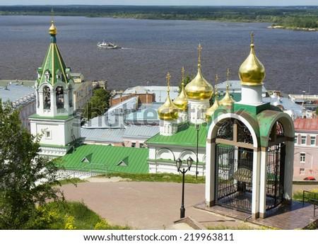Town Nizhniy Novgorod on bank of river Volga in Russia, chapel of Jusis Christ Saviour and church of Nativity of John the Baptist. - stock photo