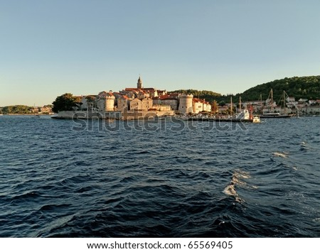 Town of Korcula and its harbour in Croatia island - stock photo