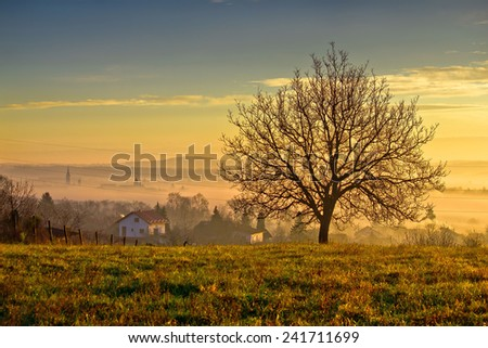 Town of Krizevci  and landscape in morning fog, Prigorje region of Croatia - stock photo