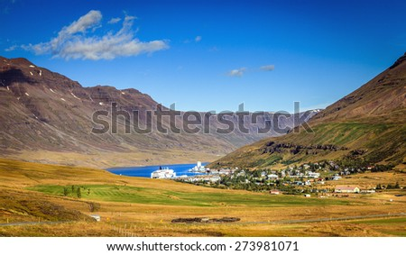Town of Seydisfjordur in Eastern Iceland and the fjord - stock photo