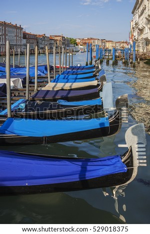 Town of Venice. Gondolas anchored in a row on Grand Canal, Italy