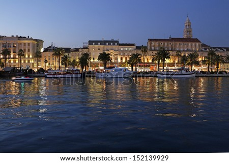 Town Split in Croatia, Diocletian palace and St Domnius cathedral viewed from seaside - stock photo