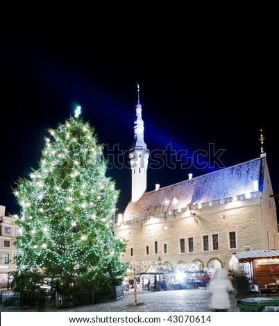 Town square view with town hall and decorated fir tree shortly before Christmas - stock photo