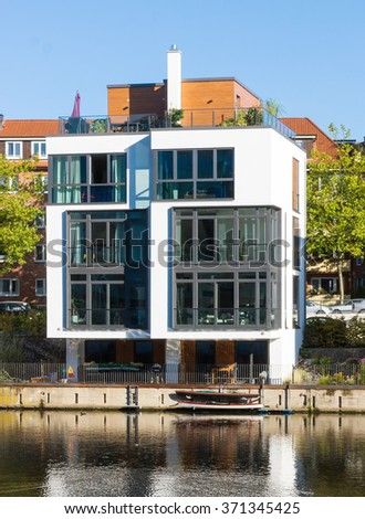 Townhouse at the waterside seen in Hamburg, Germany