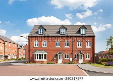 Townhouse on elegant english estate - stock photo