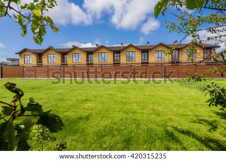 Townhouse with green lawn