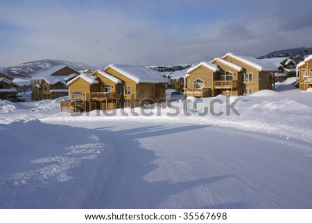 Townhouses after heavy snowstorm,		Steamboat Springs,	Colorado, Rocky Mountains - stock photo