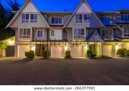 Townhouses, homes community at  dusk, night in suburbs of Vancouver, Canada - stock photo