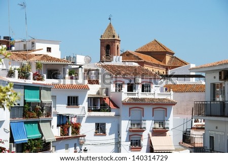 Townhouses with church to the rear, Torrox, Costa del Sol, Malaga Province, Andalucia, Spain, Western Europe. - stock photo