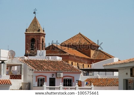 Townhouses with church to the rear, Torrox, Costa del Sol, Malaga Province, Andalusia, Spain, Western Europe. - stock photo