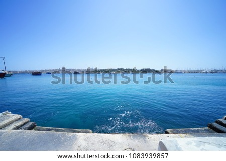 https://thumb7.shutterstock.com/display_pic_with_logo/167494286/1083939857/stock-photo-townscape-in-malta-1083939857.jpg