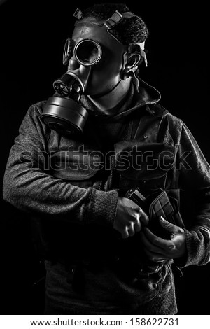 Toxic attack. A man in a gas mask in the smoke. artistic background - stock photo