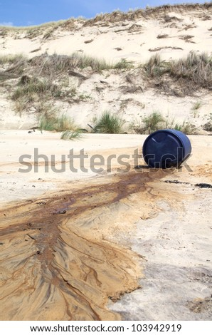 Toxic waste spilled on a beach - stock photo