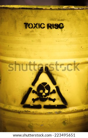 Toxic waste symbol on a yellow barrel. - stock photo