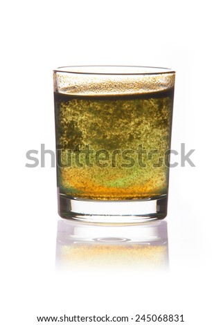 toxic water in glass with turbid sediment, yellow and green color. isolated on the white background - stock photo