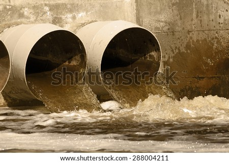 Toxic water running from sewers to the environment - stock photo