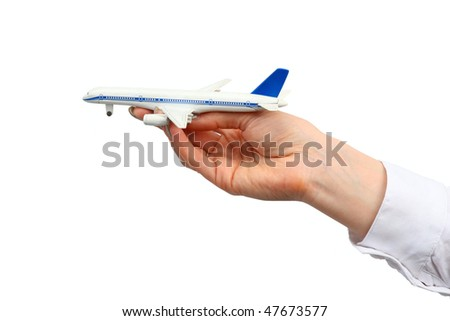 Toy airplane in hand.  Isolated on white background. - stock photo