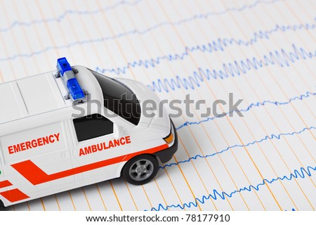 Toy ambulance car on ecg - medical background - stock photo