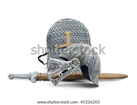 Toy armour of the knight: a board, a sword, a helmet - stock photo
