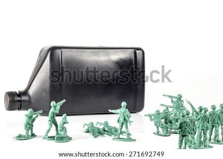 Toy army men with quart of oil symbolizing oil war in Middle East - stock photo