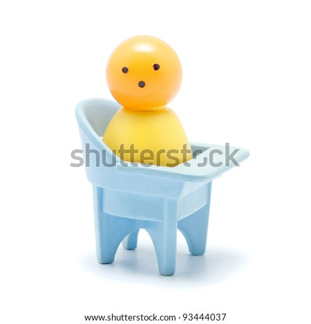 toy baby sitting on chair, isolated on white - stock photo