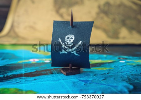 Toy boat pirate flag skull bones stock photo 753370027 shutterstock toy boat pirate flag skull and bones on the world map of the playing field handmade gumiabroncs Images