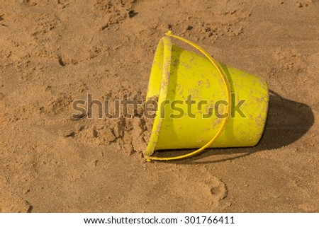 Toy bucket at the beach - stock photo