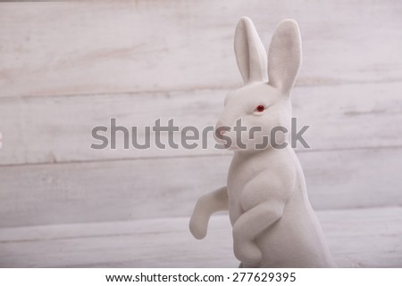 Toy bunny on white background - copy-space - stock photo