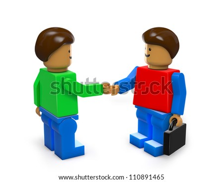 Toy businessmen made of plastic handshaking - stock photo