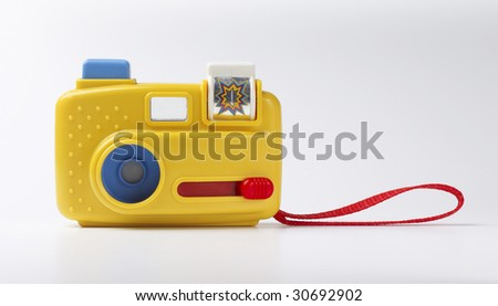 toy camera isolated on gray background - stock photo