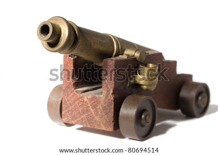 toy cannon on the white isolate background - stock photo