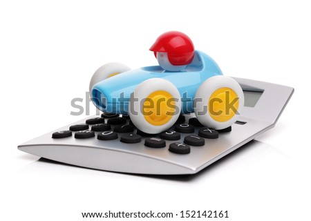 Toy car and calculator concept for buying, renting, fuel or service and repair costs - stock photo